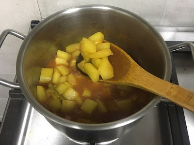 almost cooked bottle gourd and ready to add tomatoes