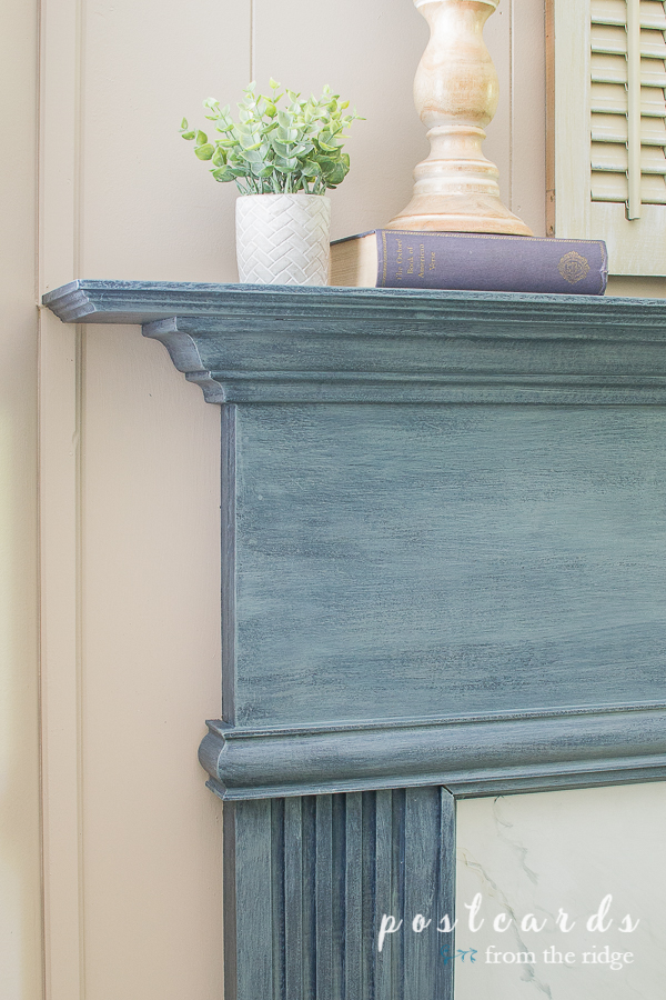 blue painted fireplace mantel