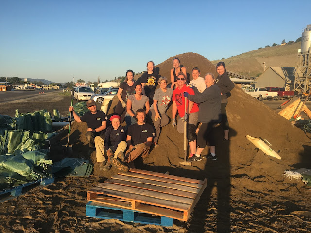 WCC members and volunteers filling sandbags in Okanogan
