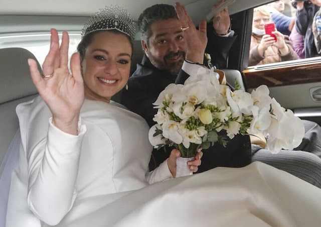 The bride Victoria Romanovna Bettarini wore a white satin gown by fashion designer Reem Acra, and the Lacis Tiara by Chaumet