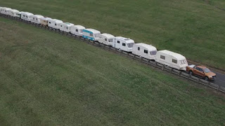 Ford Ranger towing 15-camper convoy