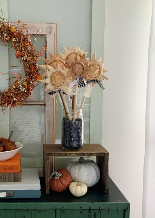 Fall Home Decor - faux pumpkins and fabric sunflowers.