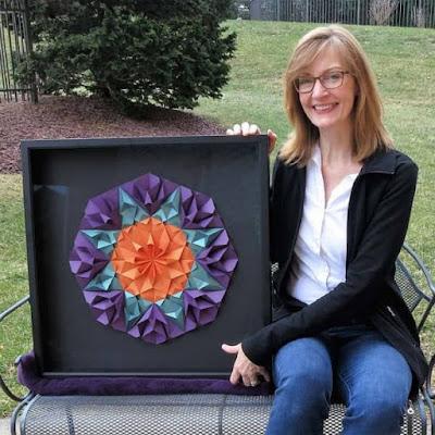 Christine Kirk displays framed mandala-style paper sculpture