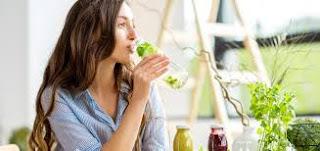 Lady drinking cucumber juice