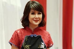 gambar presenter berita Grace Natalie
