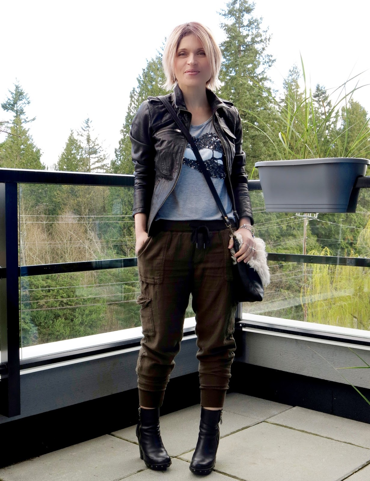 Mojo:  sequinned tee, slouchy cargos, moto jacket, and sherpa bag
