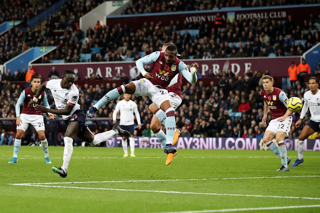 Sadio Mane scores a glancing header to give Liverpool a 1-2 win over Aston Villa in the Premier League