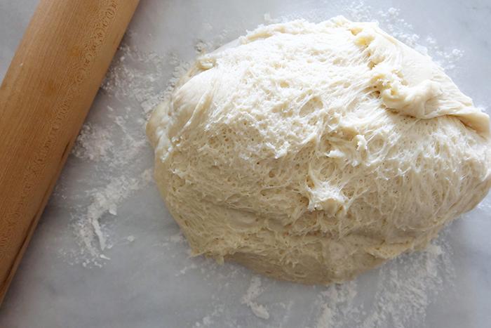 risen dough on floured surface