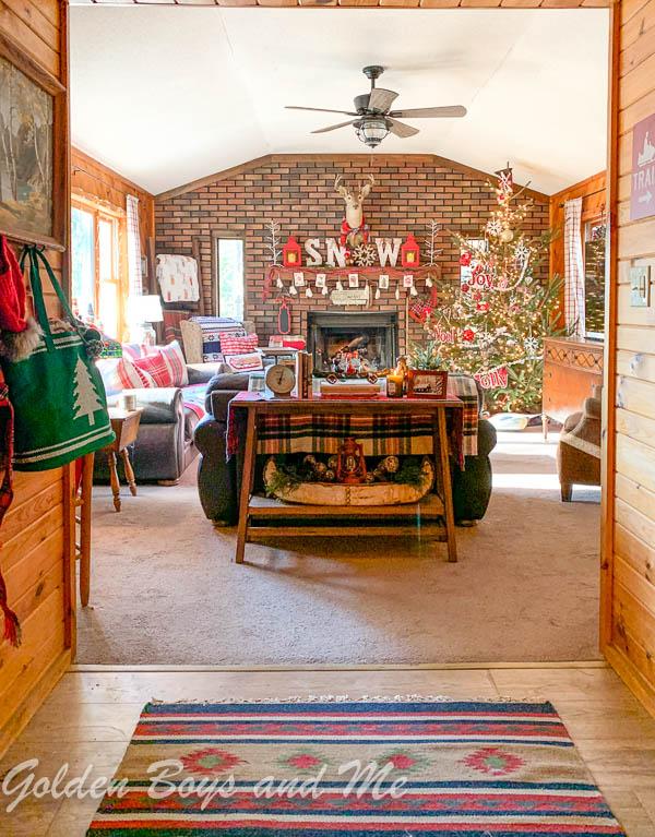 Rustic family room in Adirondack cabin - www.goldenboysandme.com