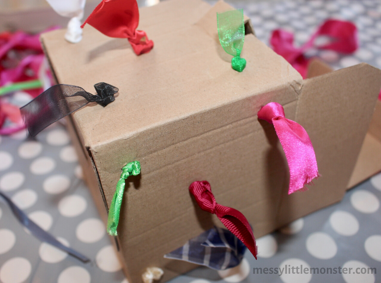 homemade tugging box fine motor toy for babies and toddlers