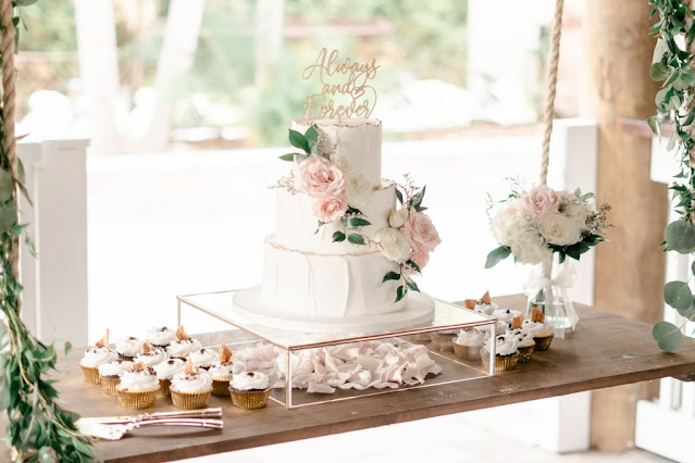 wedding cake and cupcakes on hanging tables