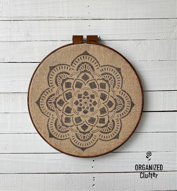Photo of framed burlap with a stenciled mandala.