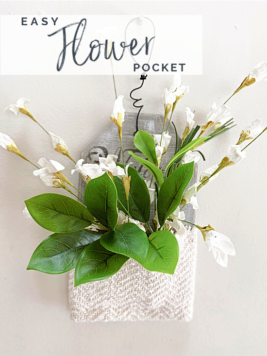 wall pocket with white flowers and overlay