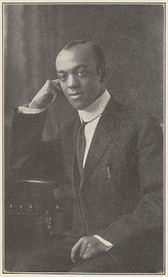 A black and white photo of Fenton Johnson leaning on his right arm and looking towards the camera