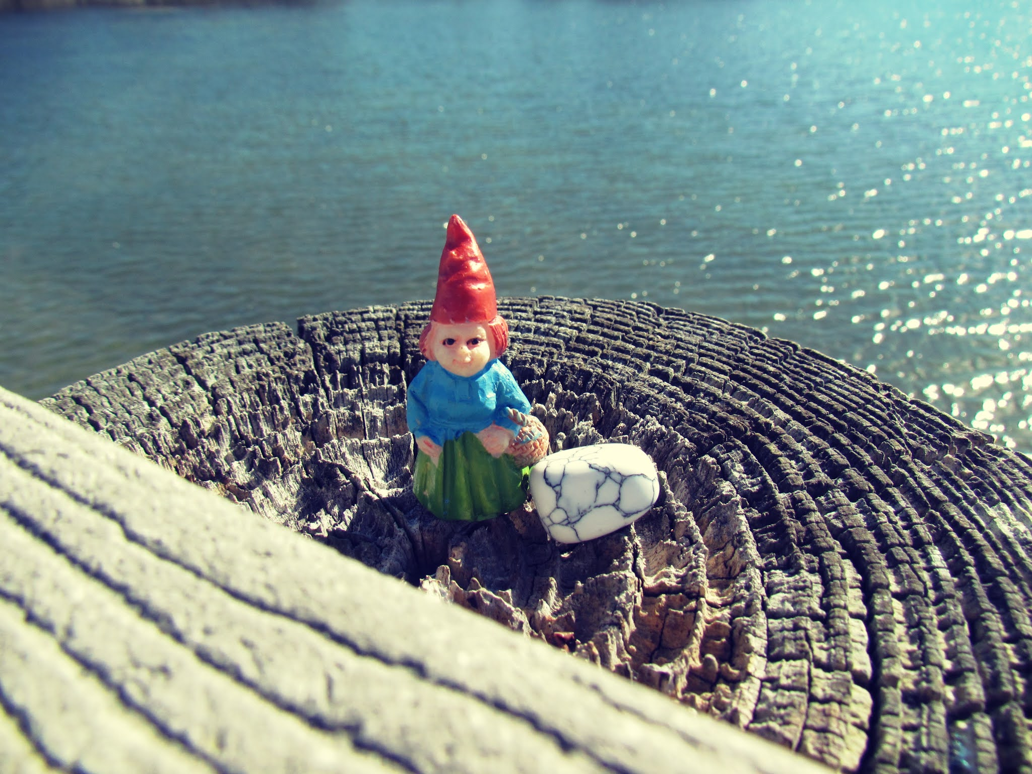 A sea witch girl gnome high priestess overlooking the sea like Morgan Le Fay of the Arthurian legend of Medieval times