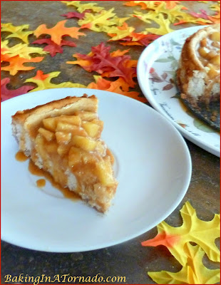 Celebrate apple season with an Apple Pie Cheesecake, apple pie flavored cheesecake with a caramel apple topping. | Recipe developed by www.BakingInATornado.com | #recipe #apple #RoshHashanah