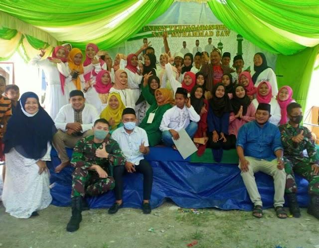 Satgas Yonarmed 9 Kostrad Menghadiri Acara Peringatan Maulid Nabi Muhammad SAW Di Masjid Dusun Air Sakula