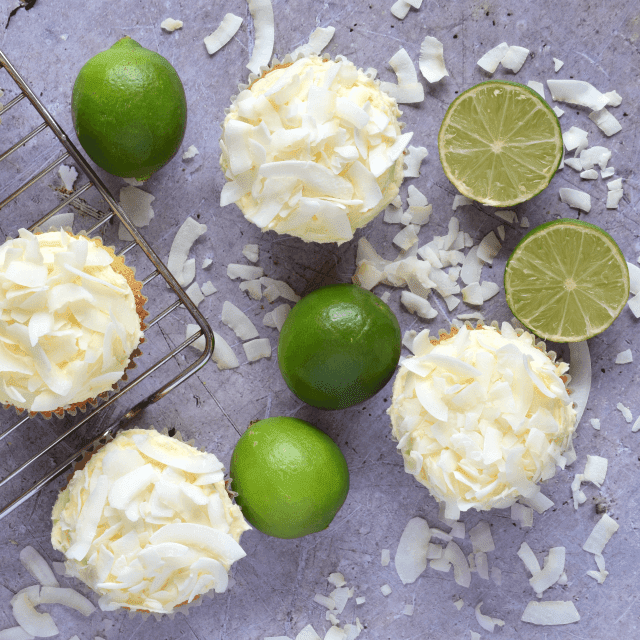 Tropical cakes filled with lime curd and topped with coconut buttercream frosting.