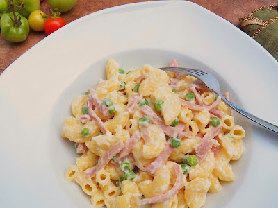 Ham and Peas Marcaroni Alfredo In Bowl With Fork