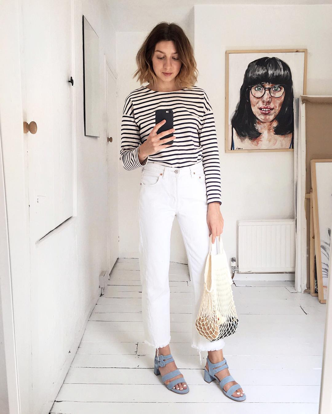 ow to Wear a Striped T-Shirt for Spring — Instagram Outfit Idea with raw-hem white jeans, mesh tote, blue suede sandals