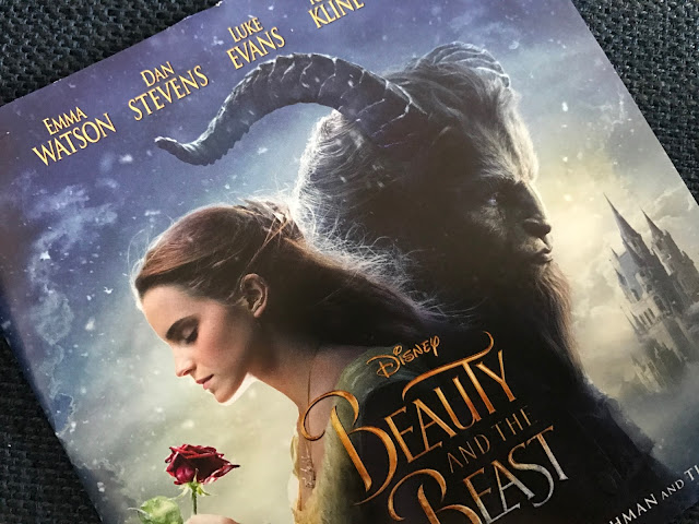 Photo of Beauty and The Beast Album artwork showing Belle (Emma Watson) and a beast.
