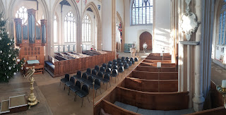 A church where a third of the pews have been replaced with chairs