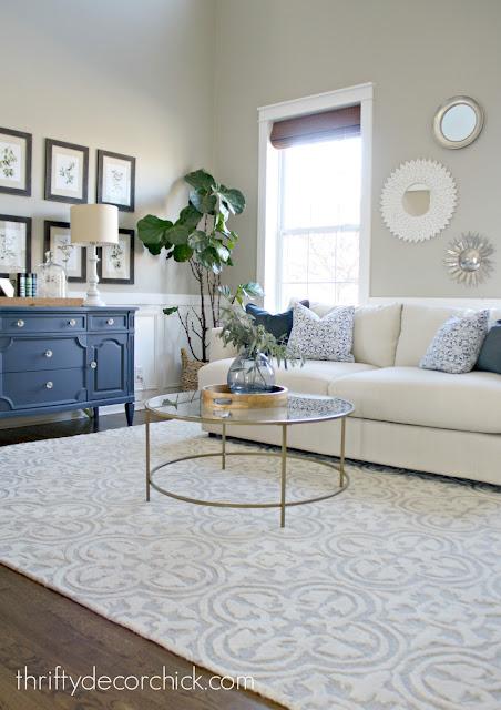 living room with dark blue dresser