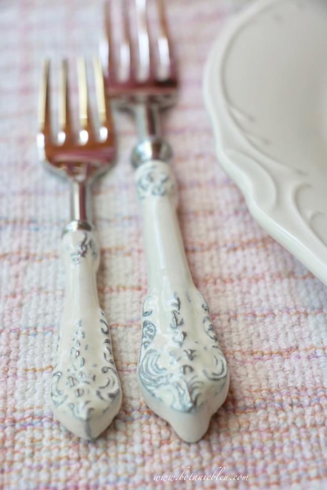 French country early summer table setting with beautiful new French white scroll enamel flatware