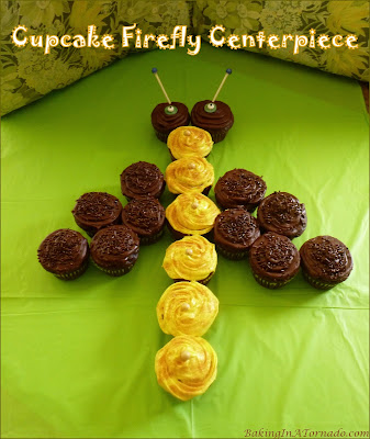 A Cupcake Firefly Centerpiece is perfect for summer parties or cookouts. Cupcakes are decorated and assembled for a fun edible centerpiece. | Recipe developed by www.BakingInATornado.com | #recipe #summer