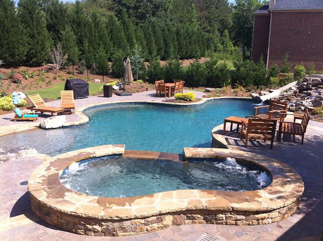 backyard oasis pools free form pool beach entry rock. Black Bedroom Furniture Sets. Home Design Ideas