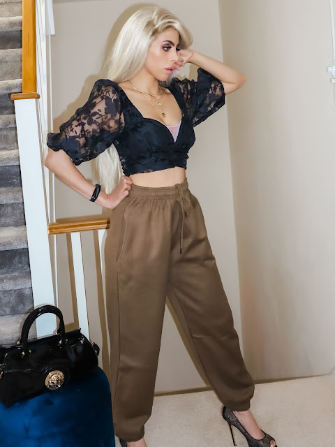 The Femme Luxe Dark Green Cuffed Joggers in model Lizzie
