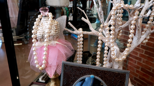 Image: Pearls hanging on the tree at the secondhand store