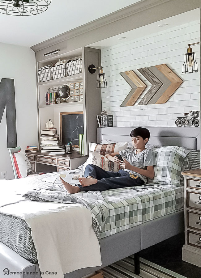 DIY Arrow wall art - Industrial teen bedroom, plaid, brown, chalkboard, wire baskets, build-ins around bed, upholstered bed