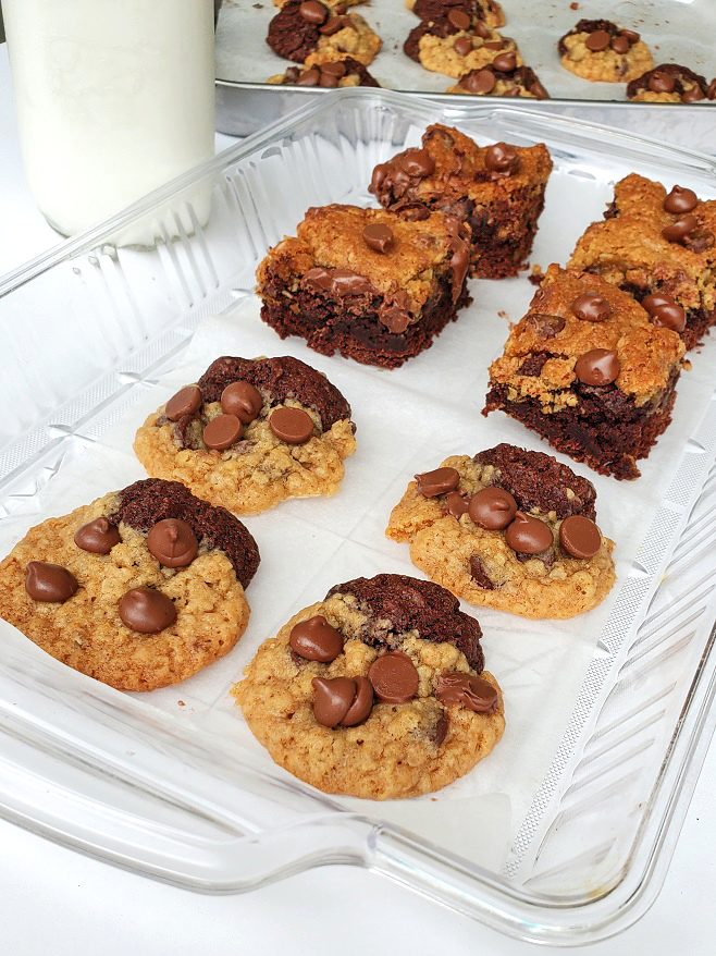 half chocolate chip and half brownie on a clear plastic tray and a bottle of milk