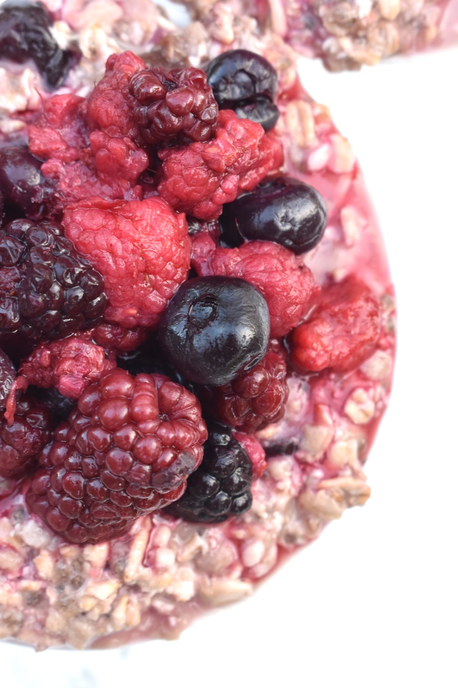 Bowl of oatmeal topped with berries