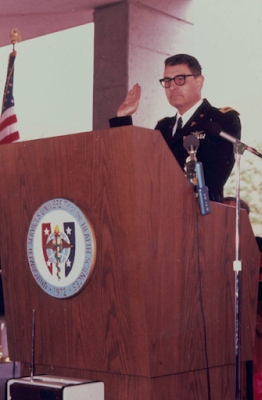 Army Col. (Dr.) Robert Joy leads the Hippocratic Oath during the first USU Commencement ceremony in 1980.  (Uniformed Services University photo)