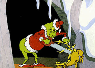 The Grinch hiding from Cindy Lou in How the Grinch Stole Christmas movieloversreviews.blogspot.com