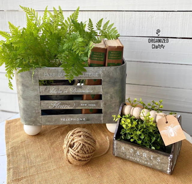 Photo of two upcycled galvanized containers with greenery