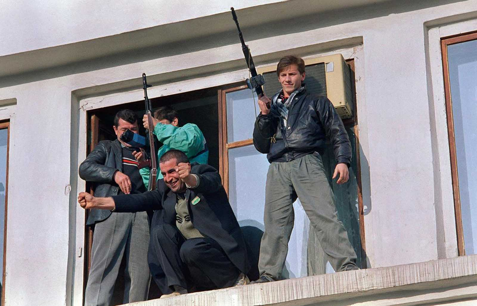 A jubilant Chechen secessionist with clenched fists opens his arms to the crowd during a rally in Grozny, on November 14, 1991, to celebrate the pullout of Soviet troops from the Muslim enclave in Southern Russia.