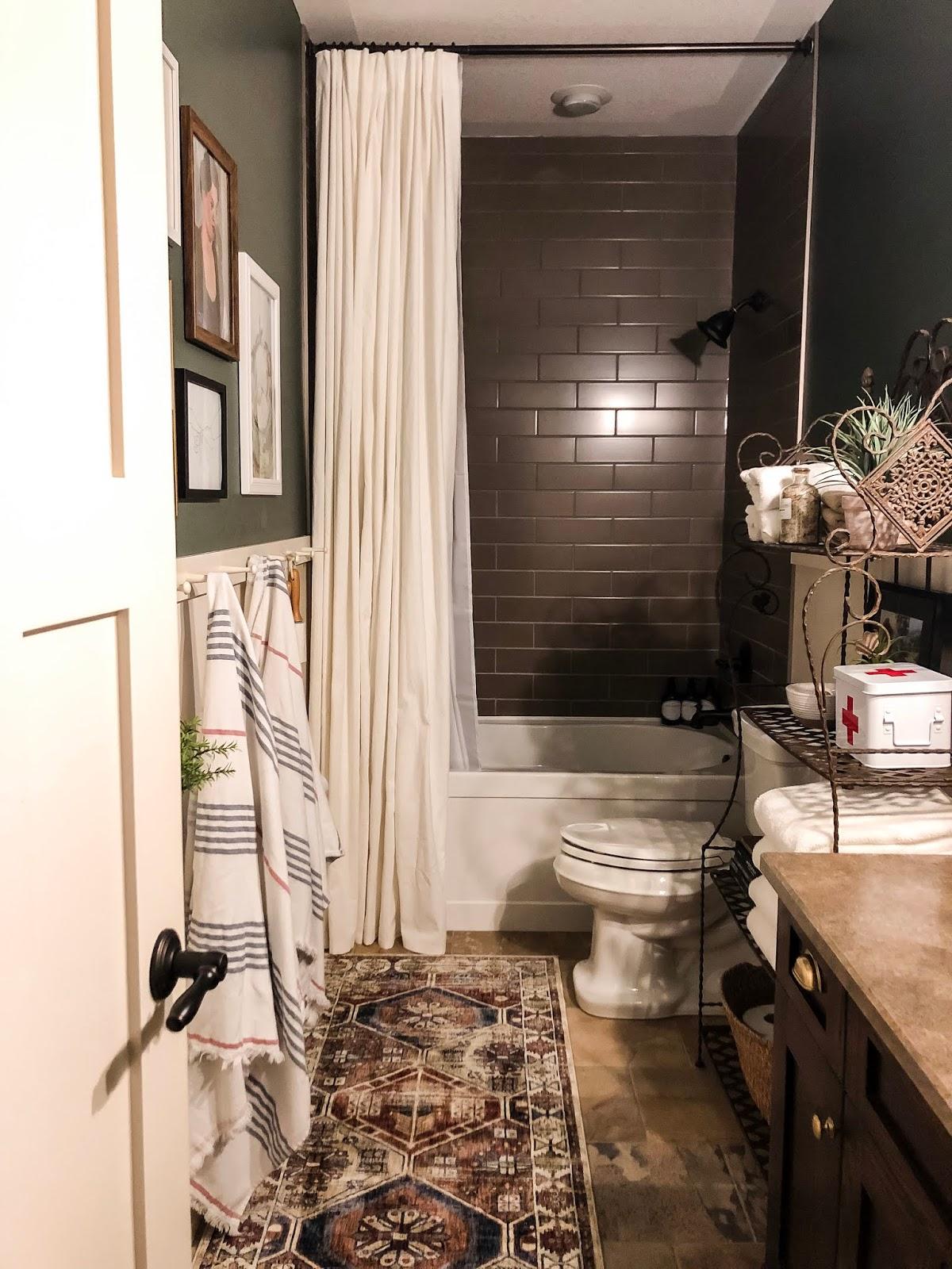 Raise the shower curtain to make bathroom feel bigger