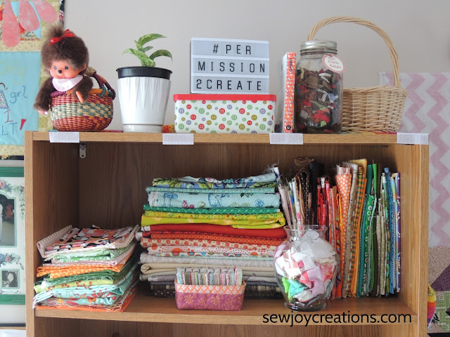 fabric folded bookcase display quilt room sewing room