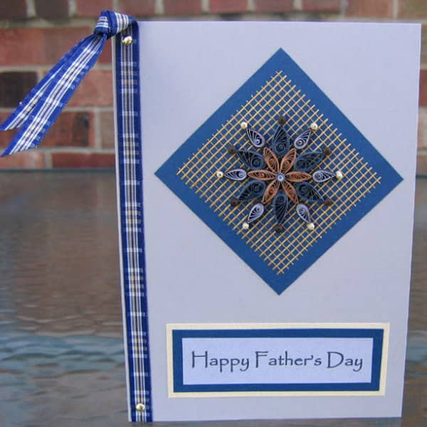 quilled mandala centered on front of Father's Day card with plaid ribbon accent