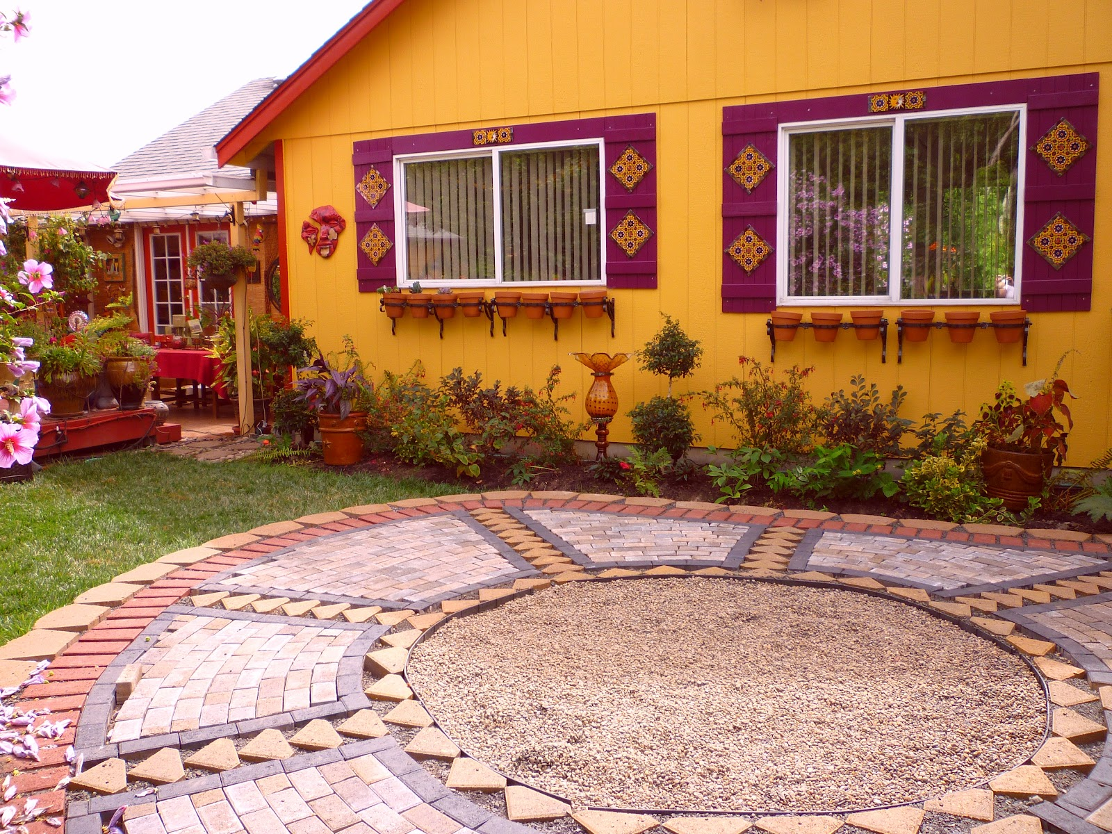 Wow, thats a busy Garden!: Creating A Paver and Pebble ...
