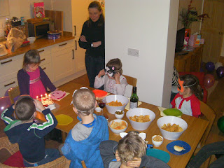 singing happy birthday with cake and party masks