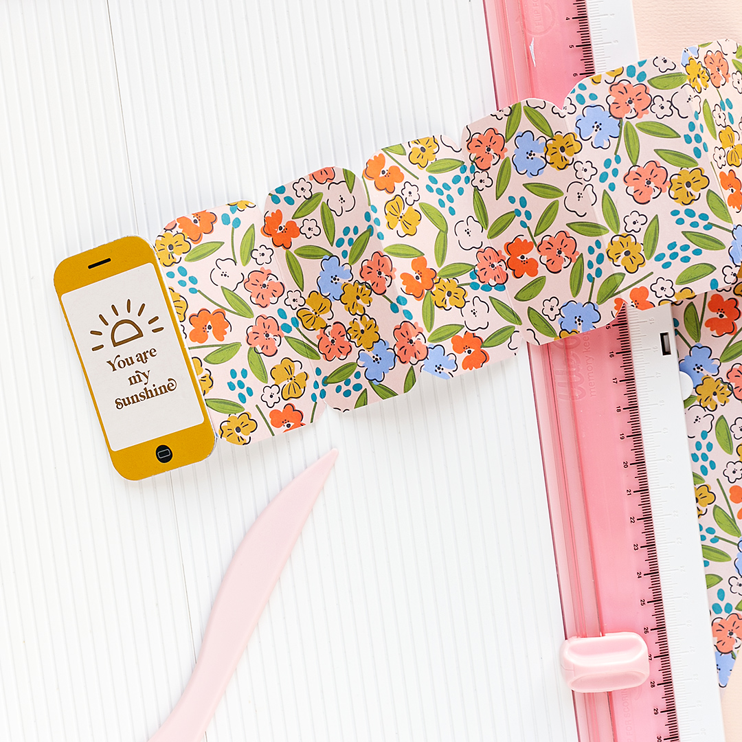 A smartphone mini album accordion style made from patterned scrapbook paper