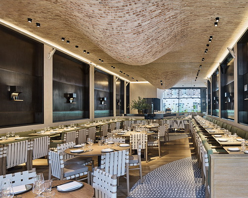 Tinuku Design interior Fucina restaurant with two bells brick roof dripped by Andy Martin Architects