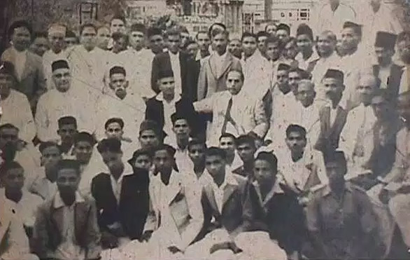Dr. Ambedkar at the gathering of prominent social workers and activists of the Independent Labour Party at Mumbai. On the right of Dr. Ambedkar are M/s. C.N. Mohite Guruji, Sambhaji, Tukaram Gaikwad, Acharya Moreshvar Vasudev Donde and Mr. Ganpat Mahadev Jadhav