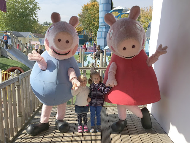 Tin Box Tot holding hands with Peppa and George