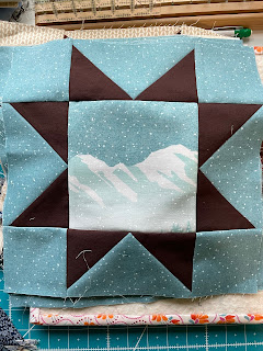 Variable Star quilt block with mountains in the center