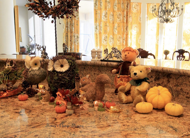 Rustic Fall decor with owls, Steiff bears, acorns, and candles